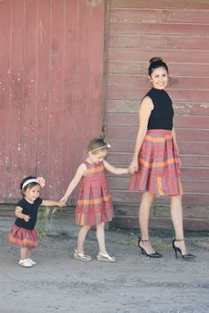 """This is Cristen - """"A California mommy to a spunky little four-year old girl, Charlotte (aka Charlee), a sassy one-year old little girl, Kendall, and wife to her hard working {fitness-loving} husband."""" She is the the owner/editor of http://TheNapTimeReviewer.com & http://TheBucketListMom.com. Cristen and her adorable two daughters dressed up in our """"Graphic Red Stripe"""" matching outfits for their mommy and me photo shoot. Super cute!"""