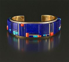 14K gold cuff bracelet inlaid with lapis, turquoise and coral by Charles Loloma (Hopi)