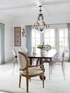 LOVE THIS DINING ROOM. . .especiall with the clear chairs!!!