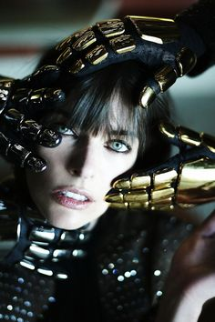 "Model: Milla Jovovich. With Daft Punk, don't know the photographer. Wait, how was Milla Jovovich not in ""Tron: Legacy""...? That does not compute. Get it? ...Compute?"