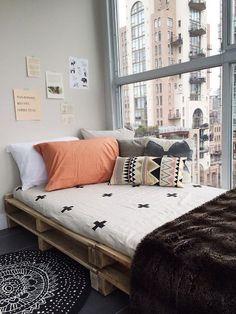 small home. rug. bedspread. pillows. texture. pattern. color. big bright windows. diy decor.