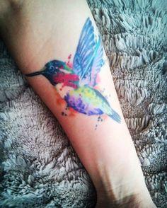 A colorful hummingbird tattoo.