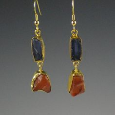 These earrings feature rough, raw blue kyanite stones, with raw carnelian stones. Earrings are set in hammered 22-karat gold-plated brass bezels. UK seller. £13.99