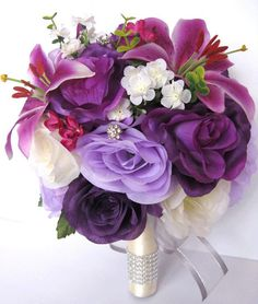 Lots of bride-to-bes may understand the wedding event flower they desire in their own arrangement, but are a little mystified about the remainder of the wedding flowers needed to complete the event and reception. Purple Flower Bouquet, Purple Wedding Bouquets, Bridal Flowers, Flower Bouquet Wedding, Silk Flowers, Bridal Bouquets, Purple Flower Centerpieces, Tall Centerpiece, Centerpiece Wedding