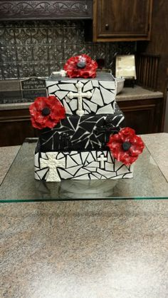 Mosaic black and white cross cake with red flowers a sweet 16 birthday cake