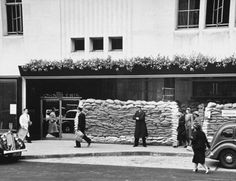 London at War 1939 - The John Lewis store on Oxford Street    sand bags were used as blast walls built around door entrances - the measures being taken in London to prepare for World War II.