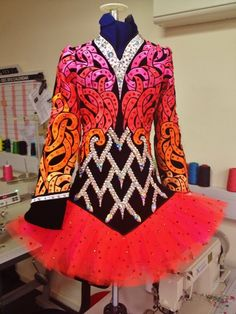 love the colours and pattern, the skirts not my favorite but I still love the dress