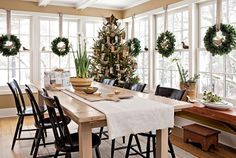Frank and Andra Mollica deck the halls in high, yet handcrafted, style, creating newspaper birds and personalized tags for holiday decorating in their Connecticut home.