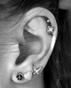express yourself with multiple ear piercings, I need to do this, now that my hair is shorter.