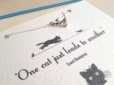 Silver Cat Charm Necklace with Ernest Hemingway Quote by LiteraryEmporium on Etsy, $15.00
