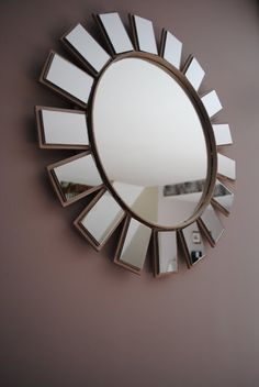 Starburst mirror tutorial - could be cute in a nursery.