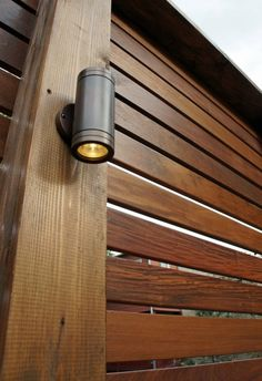 """Ipe slat fence.  Lights do not shine in anyone's eyes and create a great """"glow"""" that makes everyone look good in the evening!"""
