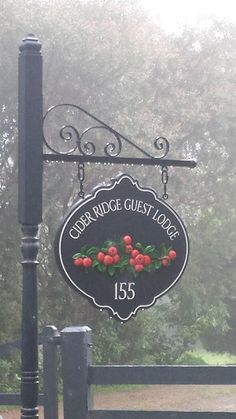 A lovely photo of our Cider Ridge Guest Lodge sign on a rainy day in Victoria! / Danthonia Designs Twitter Feed