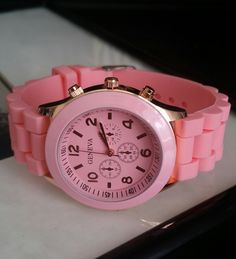 Arm candy pink silicone band watch