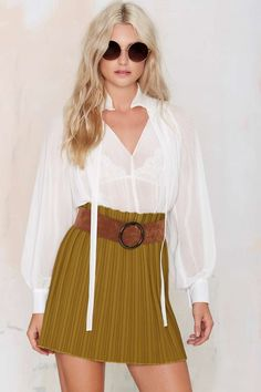 This fall, pair your closet with some classics like Dahlia Pleated Skirt.