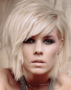 Stunning short hairdo, cut in uneven short layers for sheer bouncy and rocking style