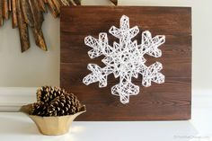 DIY Snowflake String Art Tutorial {plus 18 Easy to Build Christmas Projects}