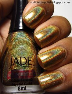 "NS Jade ""Mystic Gold"" via Addicted to Polish - The most insane gold holo I've ever seen!  I just want to sit and stare at the bottle."
