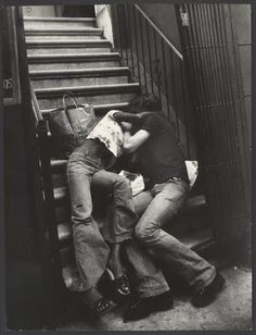 Couple kidding on building steps, NYC, 1970s by Leon Levinstein