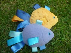 Taggie Baby Toy - Fish - blue / yellow / turquoise. £6.00, via Etsy.