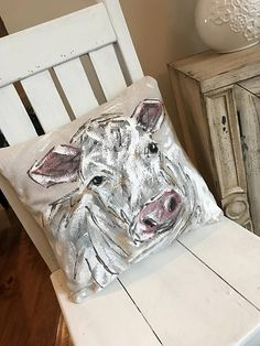 Farmhouse Cow, Cottage, White on White, Farmers Gifts, Accent Pillows, Decorative Pillows, Hand-painted Pillows, Pillow Cover This white cow pillow cover is what you need to complete your farmhouse style. Pillow cover is hand-painted on medium canvas fabric. Easy accessible back overlaps to fit pillow insert. Designed to fit a 18 x 18 inch insert. Insert not included. **NOTE** This listing is for the pillow cover ONLY. If using outside we suggest using Scotch Guard. FREE SHIPPING USA on all…