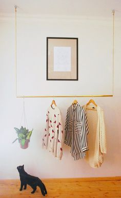 Why put all your beautiful clothes and shoes in a closet? This brass clothes rack is not only functional, but can also be very stylish in your hallway or