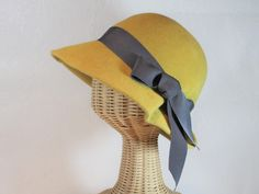 """sculptural cloche with side pleat angora felt is soft and velvety, and perfect in the rain brim is about 3"""" in front and 3.5"""" on the sides handmade here at the shop in Portland, OR measures about 22 i"""