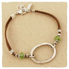 Hammered sterling oval and peridot bracelet on brown cord