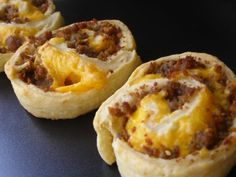 Made these this morning, they were a HIT! sausage pinwheels. super easy...crescent roll sheet spread evenly with cream cheese, sausage and cheddar cheese. roll up and bake in oven for about 15 minutes or until golden brown...