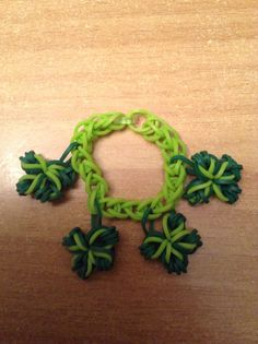 Rainbow loom basic bracelet with four leaf clover charms that I designed