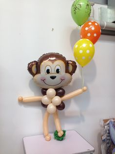 Mini monkey balloons decoration. Made by Let's Celebrate Parties.