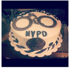 NYPD Cake     Specialty Cake;  Red Velvet Cake filled with White Chocolate Butter Cream <3