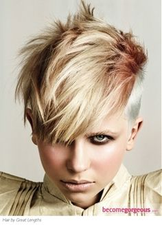 Undercut with a crazy color combo, silver, copper and blonde, love!