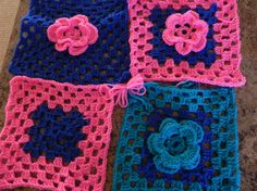 Well done!! Eileen O's first attempts at flowers. www.knit-a-square.com