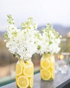 YELLOW AND GREY CENTERPIECE @Sally McWilliam McWilliam McWilliam Weigandt  Youre are going to be my creative genious!