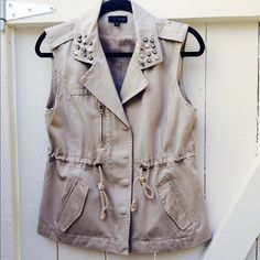 "PRICE SLASHEDSALE Limited time  Trendy tan color cargo vest with drawstring! Embellished collar. Snap and zipper closure. Perfect to dress up and style that chic outfit.  Vertical 4"" faux zipper on right side and two usable side flap pockets! Worn only a couple of times! Excellent condition, no stains, no rips!  Like new✨Professionally dry-clean and ready for a new home!  Jackets & Coats Vests"