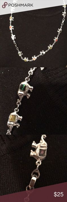 Vtg silver elephant chain that has each with stone This Vtg silver elephant chain is unique because each little elephant has a different stone in it. There are many tiny elephant in this chain which is 15 inches long. Elephant lovers will want this one because it is so different. Preowned but in excellent condition. Proceeds from this closet support Project Hope A ministry to on this single moms and their two children Jewelry Necklaces