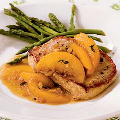 Pork Chops with Bourbon-Peach Sauce | MyRecipes.com