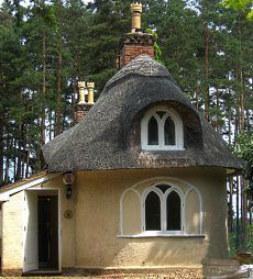 This English cottage has a pair of brick chimneys with elaborate clay chimney pots, as well as Gothic style windows with pointed arches. Fairytale Cottage, Storybook Cottage, Cozy Cottage, Cottage Living, Cabin Homes, Cottage Homes, Thatched House, Thatched Roof, Tiny House Nation