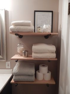 Easy to make rustic shelves for the bathroom using steel plumbing