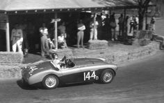 Wonderful period photo of an Austin Healey in competition. I love the leather hood strap, bonnet louvers and ::shudder:: complete lack of roll bar.     And did drivers really race in thin t-shirts?    Yes they did.