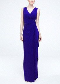 Elegant and stylish, this long jersey dress will make you look and feel beautiful!  Sleeveless bodice features a figure flattering side drape detail with brooch accent.  Long jersey dress creates movement and is comfortable to wear all night long.  Fully lined. Imported polyester/spandex blend. Hand wash cold.