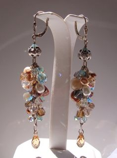 A medley of mother of pearl, freshwater pearls, keishi pearls, swarovski crystals and gemstone beads.