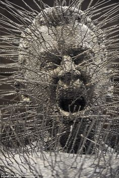 A sculpture of Jesus on the cross made entirely from wire coat hangers has been put on display at Southwark Cathedral.Tuner Prize nominee David Mach's piece, entitled Die Harder, depicts the figure of Christ screaming in agony.The dramatic sculpture was made from 3,000 coat hangers with the hooks straightened so they appear to be sticking out of the body.