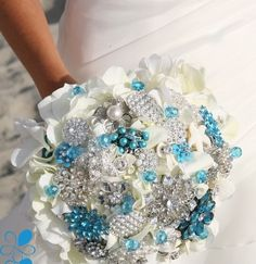 Turquoise Hydrangea Brooch Bouquet: Cream hydrangeas with turquoise accents… Hydrangea Bouquet Wedding, Blue Hydrangea, Wedding Flowers, Prom Flowers, Bouquet Flowers, Wedding Dresses, Wedding Brooch Bouquets, Crystal Brooch, Wedding Wishes