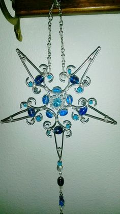 Wire wrapped snowflake. Beaded sun catcher.