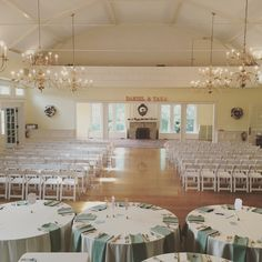 The very flexible Glendale Lyceum ballroom is shown here set for a Tea Room ceremony. A curtain is pulled to hide the set tables from view. After the ceremony, the curtain is removed and the ballroom can be flipped for the reception, while guests enjoy cocktails and hors d'oeuvres on the sun porch or in the library.