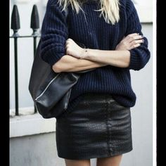 Faux Leather Black Mini Skirt 25% off when bundle Cute skirt to wear out or would look adorable with a sweater. 1st pic is not actual skirt...for styling purposes only. Great condition. H&m runs small... Is a size 8 but Would fit size 4/ small. Has zipper in front and material has some stretch to it H&M Skirts Mini