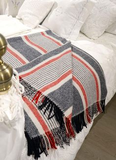 4th Of July Throw - Perfect for the 4th of July celebrations! This soft and luxurious wool cashmere throw comes in a classic mix of red, white and blue colors in a stripe detail.