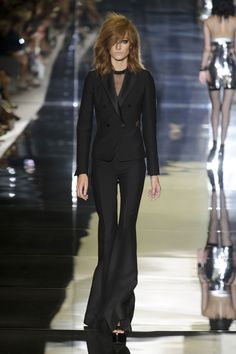 A tuxedo for evening is not a new proposition by any stretch, and yet it looked just right here. The tousled hair, the kohl-rimmed eyes and nude lips; the sheer t-shirt peeking out beneath a buttoned-up suit. Don't mess with this chick.    - HarpersBAZAAR.com